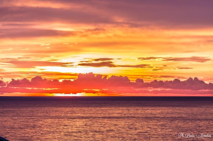 rimini-alba-sole-dietro-le-nuvole